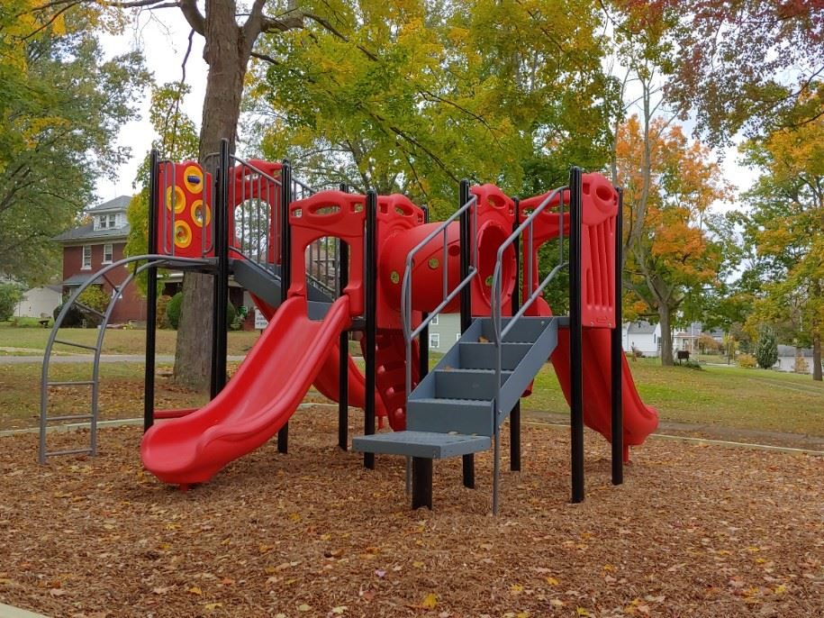 Red and Black Playground Equipment with Slides